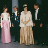 President and Mrs. Kennedy greet the Shah and the Shahbanou of Iran.